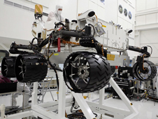 Engineers working in a clean room at the Jet Propulsion Laboratory installed six new wheels on the Curiosity rover.