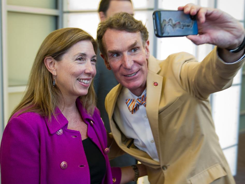 Bill Nye, known as the Science Guy, takes a photograph of himself with NASA Deputy Administrator Lori Garver