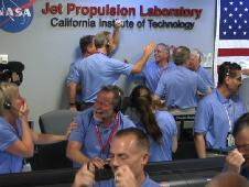 Engineers at NASA's Jet Propulsion Laboratory in Pasadena, Calif., celebrate the landing of NASA's Curiosity rover on the Red Planet.