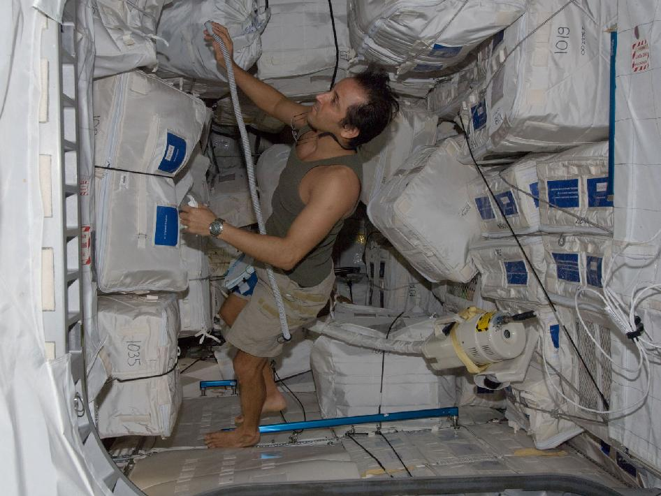 Astronaut Joe Acaba with vacuum cleaner