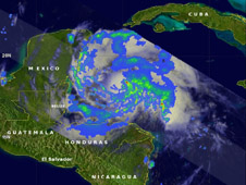 NASA's TRMM satellite had a good look at Tropical Storm Ernesto on August 7, 11:22 a.m. EDT, less than three hours before it was upgraded to a hurricane by the National Hurricane Center. Light to moderate rainfall is seen in the yellow, green and blue areas, where rain was falling between 20 and 40