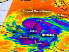 NASA's Aqua satellite passed over Tropical Storm Ernesto on August 8 at 3:29 a.m. EDT. The AIRS instrument captured an infrared image of the cloud temperatures that showed the strongest storms (purple) and heaviest rainfall were wrapped around the storm's center and in a band of thunderstorms extend