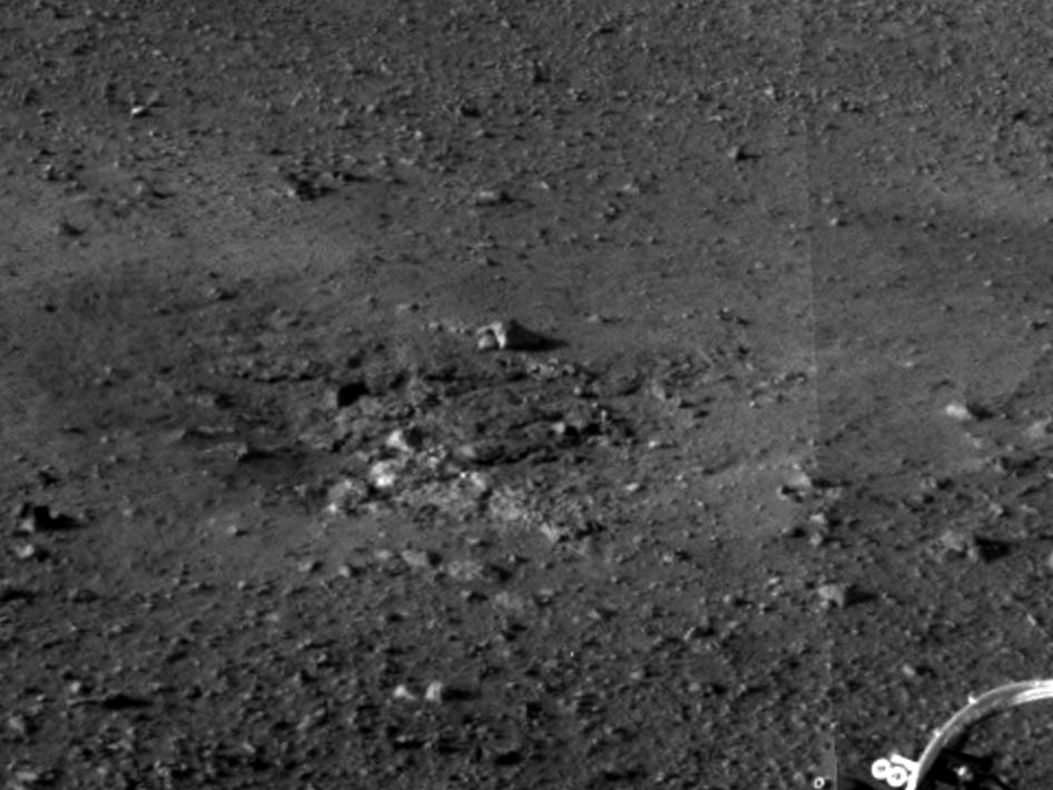 This is a close-up view of a zone where the soil at Curiosity's landing site was blown away by the thrusters on the rover's descent stage.