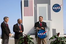 NASA Commercial Crew Program Manager Ed Mango discusses the agency's new CCiCap partnerships while Kennedy Space Center Director Bob Cabana, left, and NASA Administrator Charlie Bolden look on.