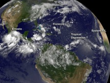 GOES-13 captured an image of four tropical systems marching across the Atlantic Ocean basic on August 10, 2012.