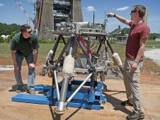 Marshall Center engineers Logan Kennedy, right, and Adam Lacock check out the lander prototype, dubbed the Mighty Eagle.