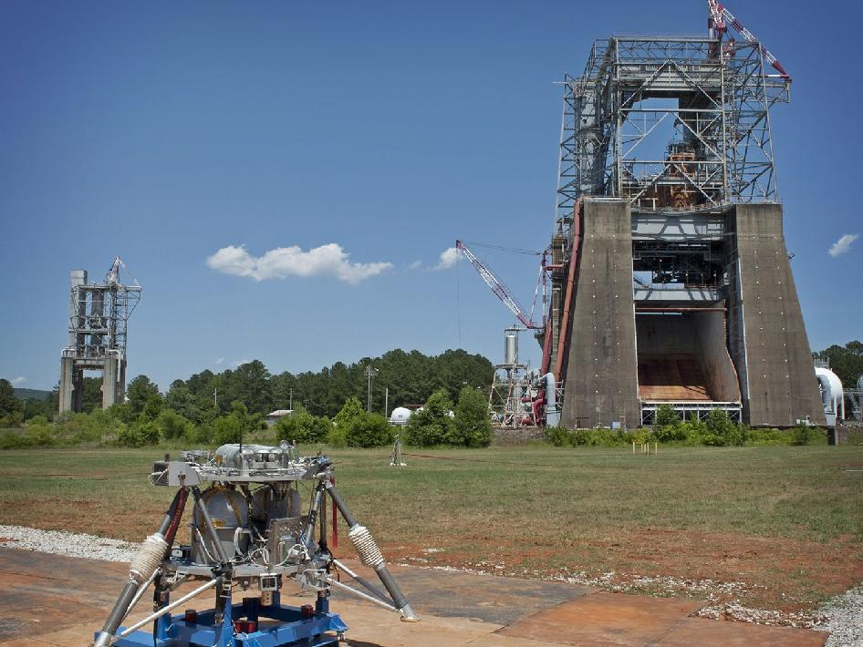 The Mighty Eagle robotic prototype lander is now being tested near Marshall's historic Saturn IC Static and F1 test stands.