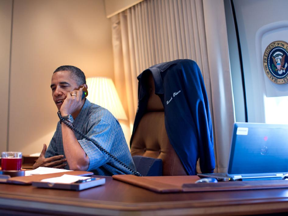 President Barack Obama talks on the phone with NASA's Curiosity Mars rover team aboard Air Force One