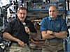 Astronauts Dan Burbank and Don Pettit on the space station