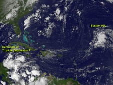 This NOAA GOES-13 satellite image from August 14, 2012 shows Tropical Depression 7 and System 93L.