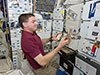 Mission Specialist Rex Walheim conducting the BRIC-SyNRGE experiment.