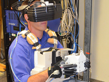 A RATS crew member uses a virtual reality laboratory interface.