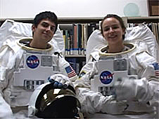 Joseph Meyer and Jessica Brodsky wearing mock-up spacesuits
