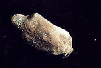 Up close photo of large asteroid with a small moon to the back