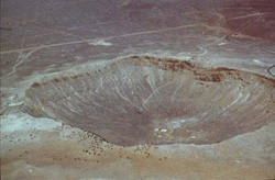 Photo of a large crater in the desert