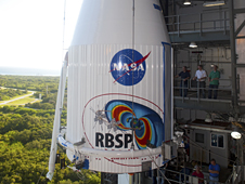 The Atlas V payload fairing containing the RBSP spacecraft is lifted at Space Launch Complex-41