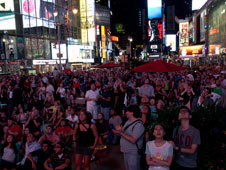 Crowds watch the The Toshiba Vision screen in Times Square during the landing of NASA's Curiosity rover on Mars. Image Credit: Toshiba