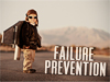 Child wearing jetpack stands near the words Failure Prevention