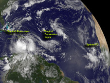 wide-frame image of the Atlantic with tropical storm formations measured from Cuba to Africa.