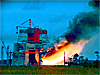 Smoke and flame from a rocket test stand