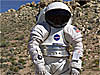 Man wears a spacesuit prototype in the desert