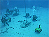 Astronauts work under water with robots