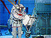 Astronaut Soichi Noguchi wears spacesuit under water in the Neutral Buoyancy Laboratory pool