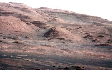 The image shows the base of Mount Sharp, the rover's eventual science destination.