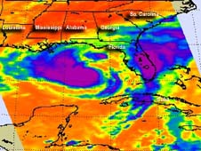 infrared image shows Tropical Storm Isaac bruising towards Texas and a large purple swath of rain of Florida and Georgia in the Atlantic