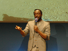 Musical artist will.i.am addresses a crowd of students at NASA's Jet Propulsion Laboratory in Pasadena, Calif., where his new single, 'Reach for the Stars,' was beamed down from the Curiosity Mars rover and broadcast to the live audience.