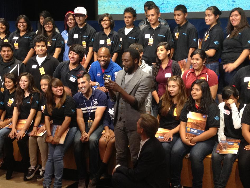 With students and NASA space shuttle astronaut Leland Melvin looking on, musical artist will.i.am posts a tweet soon after his song 'Reach for the Stars' was beamed back from the Curiosity Mars rover and broadcast to a live audience at NASA's Jet Propulsion Laboratory in Pasadena, Calif.
