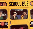 Picture of children looking out of the back of a yellow school bus