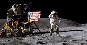 Young salutes the flag on the moon during Apollo 16