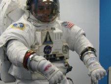 Two-time Astronaut Glove Challenge winner Peter Homer of Flagsuit LLC demonstrates the spacesuit gloves he is designing for commercial spaceflight.
