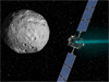 Artist's concept of NASA's Dawn spacecraft and the giant asteroid Vesta