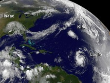 This visible image of Isaac over moving over the Mississippi Valley, and Kirk and Leslie in the central Atlantic Ocean.
