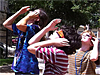 Children look toward the sky while wearing solar viewing glasses