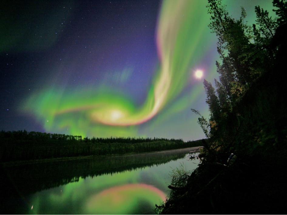 Swirls of green and red appear in an aurora over Whitehorse, Yukon on the night of September 3, 2012.
