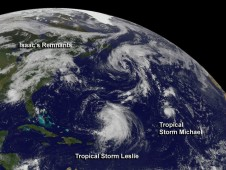 GOES-13 captured an image of Isaac's huge blanket of clouds over the U.S., and very small Michael in the central Atlantic.