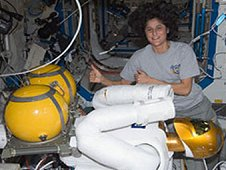 NASA astronaut Sunita Williams, Expedition 32 flight engineer, works with Robonaut 2 humanoid robot in the Destiny laboratory of the International Space Station. (NASA)