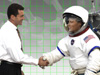 astronaut and business man handshake