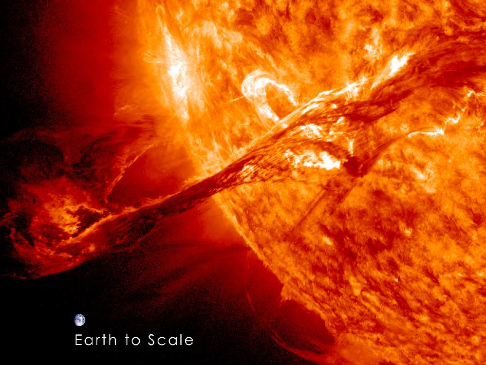 SDO's view of erupting filament on the sun with Earth shown next to it for scale.