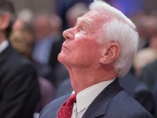 Apollo 17 mission commander Gene Cernan, the last man to walk on the moon, looks skyward during a memorial service celebrating the life of Neil Armstrong at the Washington National Cathedral, Thursday, Sept. 13, 2012.