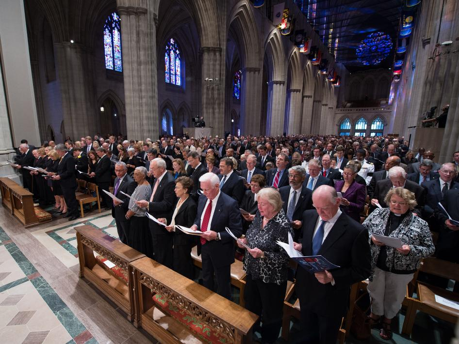 Attendees to the memorial service for Neil Armstrong sing a hymnal, Thursday, Sept. 13, 2012, at the Washington National Cathedral.