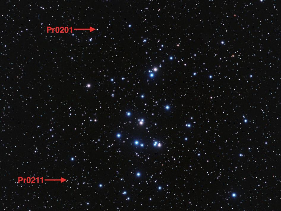 Beehive star cluster points out the location of its first known planets, Pr0201b and Pr0211b