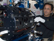 Astronaut Joe Acaba works on the MDCA Chamber Insert Assembly in the Harmony node of the space station