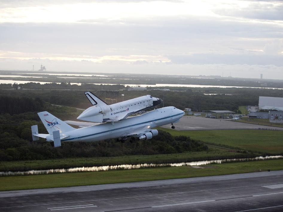 Space shuttle Endeavour takes to the sky over the Shuttle Landing Facility at NASA's Kennedy Space Center in Florida at 7:22 a.m. EDT mounted atop NASA's Shuttle Carrier Aircraft, or SCA.