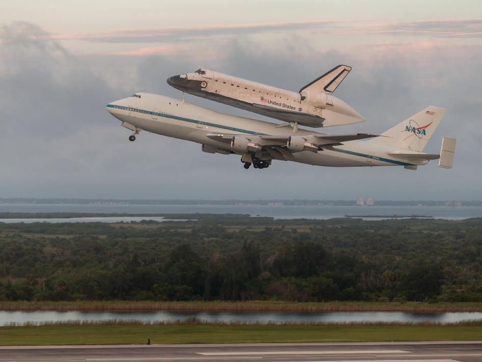 The space shuttle Endeavour, atop NASA's Shuttle Carrier Aircraft (SCA), is seen shortly after takeoff from NASA's Kennedy Space Center on Wednesday, Sept. 19, 2012 in Cape Canaveral, Fla.
