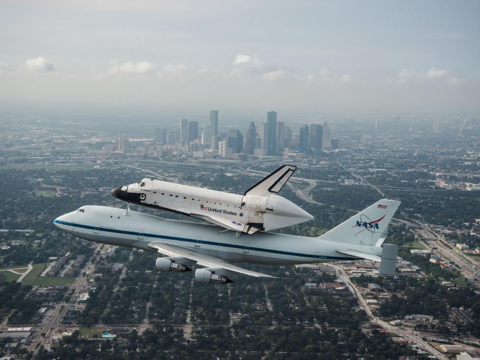 The space shuttle Endeavour passes over Houston as it is ferried by NASA's Shuttle Carrier Aircraft (SCA) on September 19, 2012 en route to Ellington Field, near the Johnson Space Center, where it is to make a scheduled stop over.