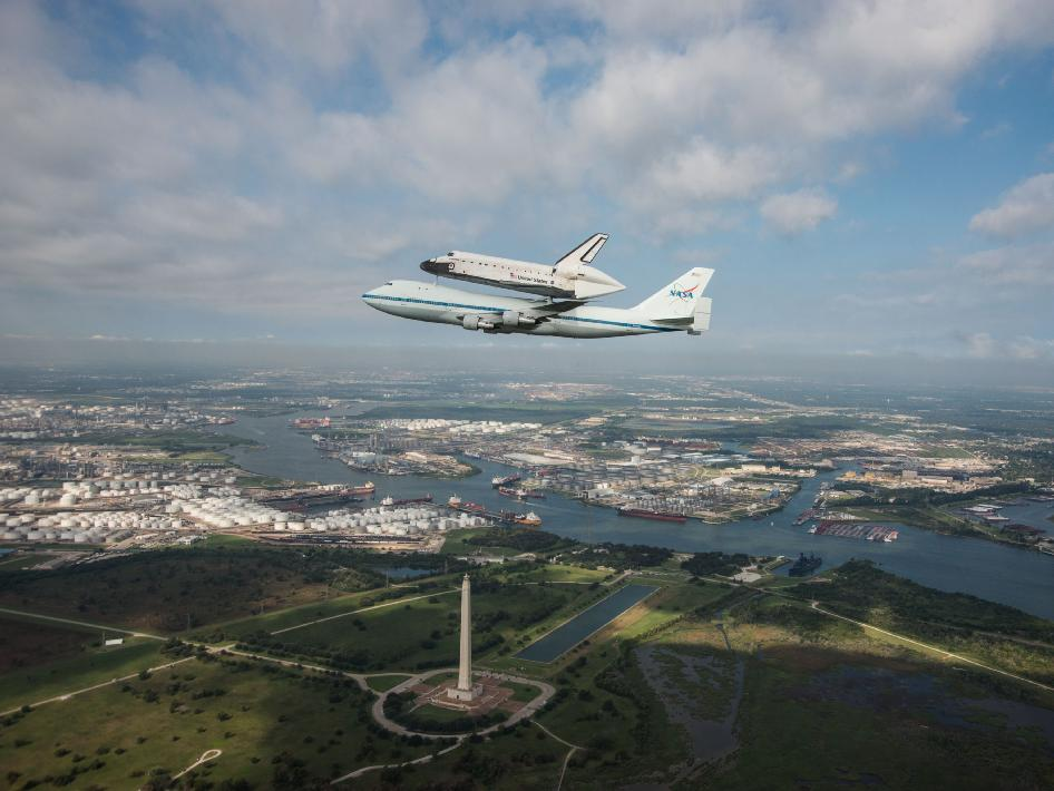 Space Shuttle Endeavour is ferried by NASA's Shuttle Carrier Aircraft (SCA) over San Jacinto Monument in Houston, Texas on September 19, 2012.